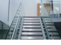 Modern full glass framless staircase and stainless steal fixtures and fittings supplied and installed in ireland.png