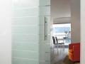 Quality Custom design modern architectural glass slide door on heavy duty sliding chrome glass sliding fixture made bespoke in Northern ireland.png