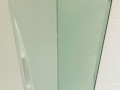 Decorative bathroom sink glass mirror with holes and safety baking made to any size shaped glass in northern ireland.png