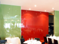 Commercial painted back coloured glass wall cladding designed and manufactured in derry city and supplied to northern ireland direct to trade.png