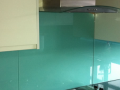 Painted glass kitchen Splashbacks  with electrical cut outs and supporting Hobb decourative glass in Northern ireland.png