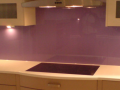 Purple Painted glass kitchen behind the Hob decourative glossy glass splash back.png