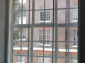 Sliding sash traditional window restoration with vertical balanced opening secondary glazing improve heat insulation meets building regulations dublin ireland