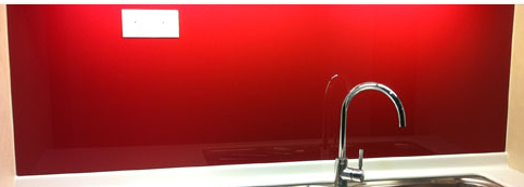 Red glass coloured splash back with glass socket cut out supplied and fitted in derry city and northern ireland